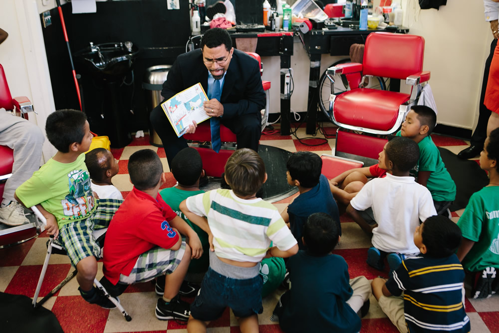 Secretary John B. King Jr. reading to a group of children